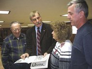 Two dozen citizens attended Delegate John Overington's legislative town meeting in Bedington on Saturday. Taking a look at his newsletter are Bill Henneberger, left, Overington, JoAnn Overington and Richard Drewry. The legislative session reconvenes Wedne